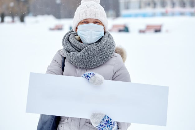 woman wearing mask in winter to prevent infection